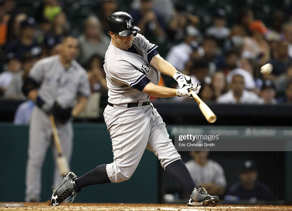 <a gi-track='captionPersonalityLinkClicked' href=/galleries/search?phrase=Mark+Reynolds&family=editorial&specificpeople=2343799 ng-click='$event.stopPropagation()'>Mark Reynolds</a> #39 of the New York Yankees hits a solo home run during the fourteenth inning against the Houston Astros on September 29, 2013 at Minute Maid Park in Houston, TX.