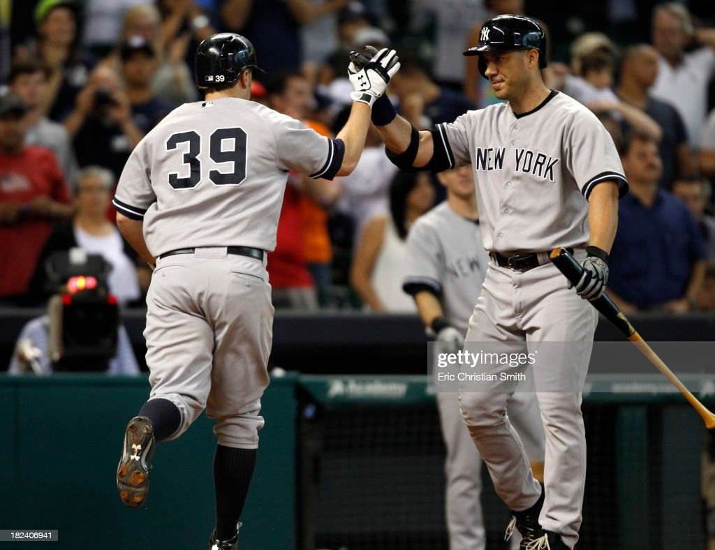<a gi-track='captionPersonalityLinkClicked' href=/galleries/search?phrase=Mark+Reynolds&family=editorial&specificpeople=2343799 ng-click='$event.stopPropagation()'>Mark Reynolds</a> #39 of the New York Yankees is congratulated by teammate <a gi-track='captionPersonalityLinkClicked' href=/galleries/search?phrase=Travis+Hafner&family=editorial&specificpeople=220556 ng-click='$event.stopPropagation()'>Travis Hafner</a> #33 after Reynolds hit a solo home run during the fourteenth inning against the Houston Astros on September 29, 2013 at Minute Maid Park in Houston, TX.