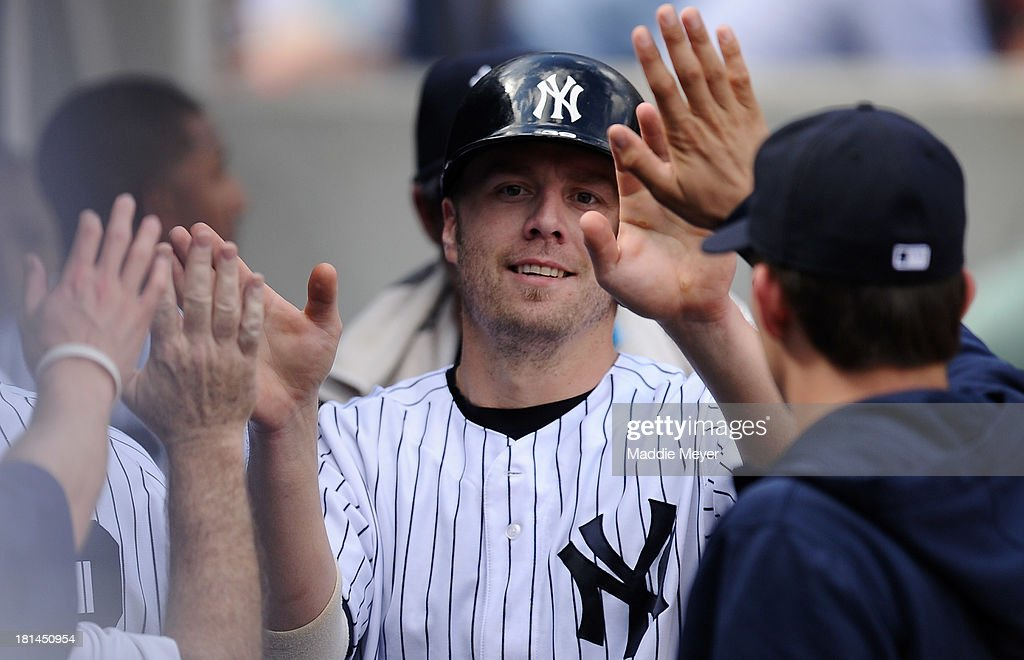 <a gi-track='captionPersonalityLinkClicked' href=/galleries/search?phrase=Mark+Reynolds&family=editorial&specificpeople=2343799 ng-click='$event.stopPropagation()'>Mark Reynolds</a> #39 of the New York Yankees is congratulated by teammates after scoring a run in the third inning against the San Francisco Giants during interleague play on September 21, 2013 at Yankee Stadium in the Bronx borough of New York City.