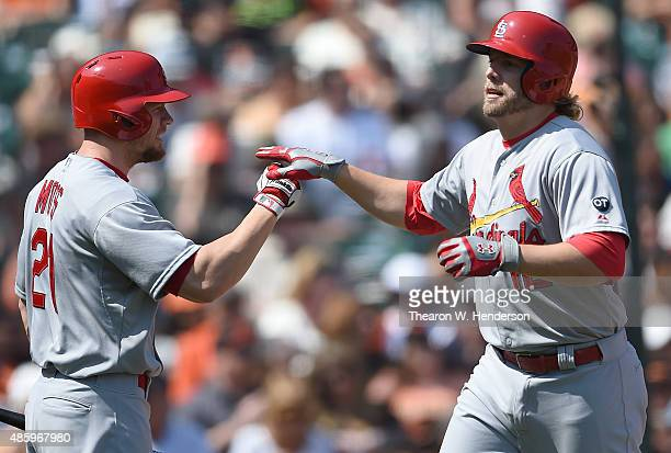 Mark Reynolds of the St Louis Cardinals is congratulated by Brandon Moss after Reynolds hit a solo home run against the San Francisco Giants in the...