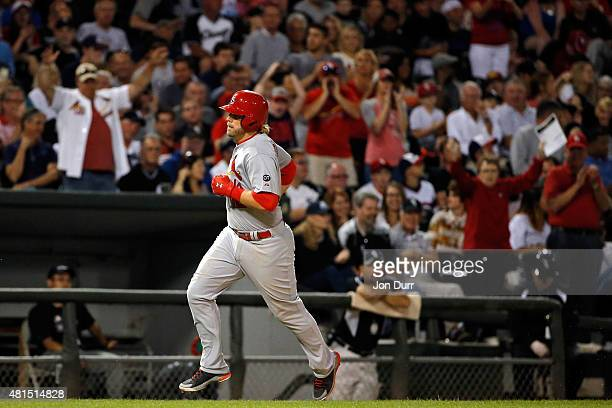 Mark Reynolds of the St Louis Cardinals rounds the bases after hitting a one run home run against the Chicago White Sox during the fifth inning at US...