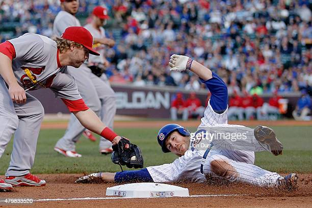 Mark Reynolds of the St Louis Cardinals tags out Chris Denorfia of the Chicago Cubs at third base during the third inning during game two of a double...