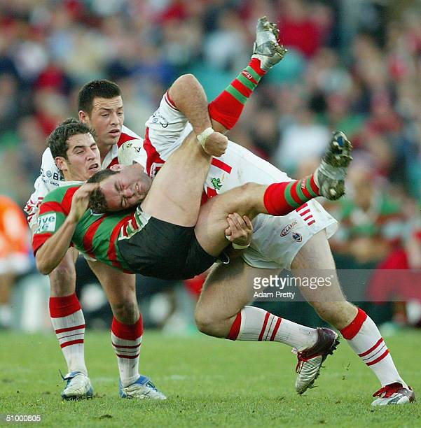 Mark Riddell of the Dragons dumps Brad Watts of the Rabbitohs during the round 16 NRL match between the South Sydney Rabbitohs and the St George...