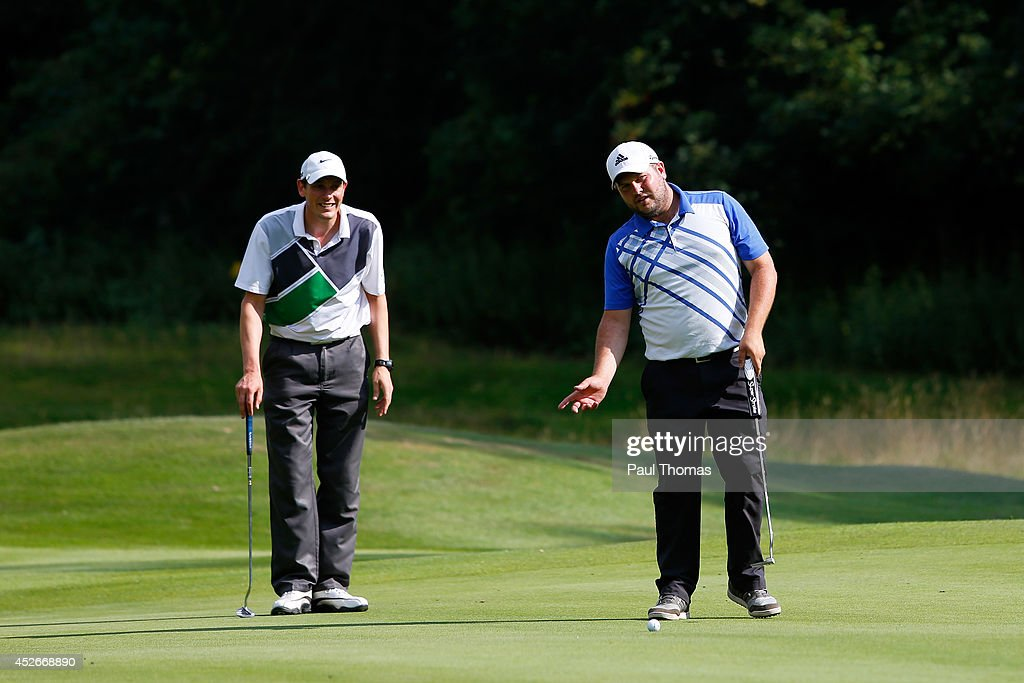 Mark Roberts (L) and Matthew Dixon of High Legh Golf Club line-up a putt during The Lombard Trophy North West Regional Qualifier at Dunham Forest Golf Club on July 25, 2014 in Altrincham, England.