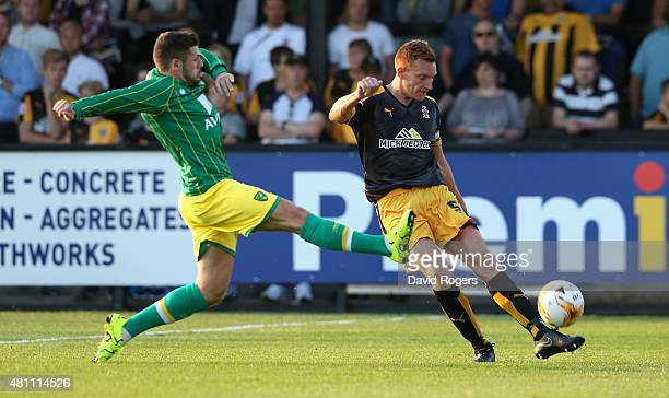 Mark Roberts of Cambridge United clears the ball as Gary Hooper challenges during the pre season friendly match between Cambridge United and Norwich...