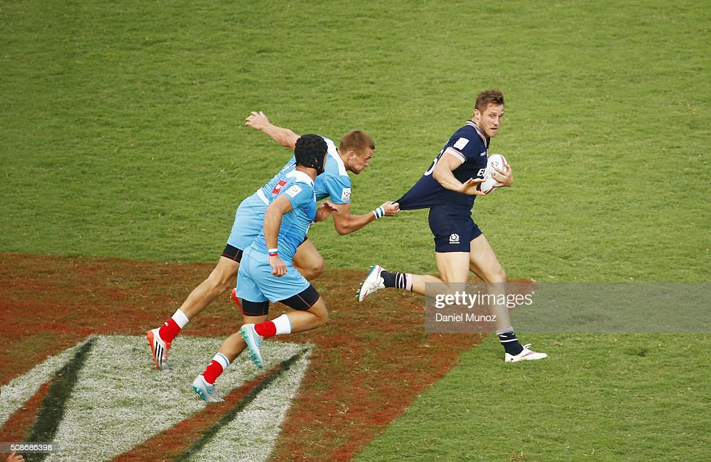 Mark Robertson of Scotland is tackled during the 2016 Sydney Sevens match between Scotland and Russia at Allianz Stadium on February 6, 2016 in Sydney, Australia.