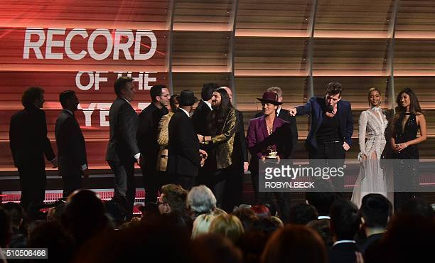 Mark Ronson accepts the award for the Record of the Year Uptown Funk as Beyonce and Bruno Mars look on onstage during the 58th Annual Grammy music...
