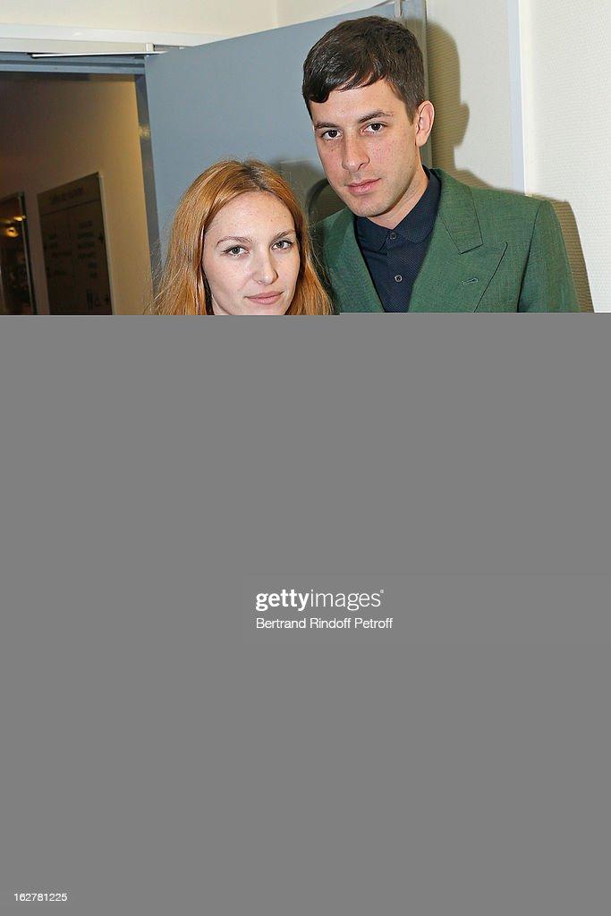 Mark Ronson (L) and his wife Josephine de la Baume pose backstage following the Etam Live Show Lingerie at Bourse du Commerce on February 26, 2013 in Paris, France.