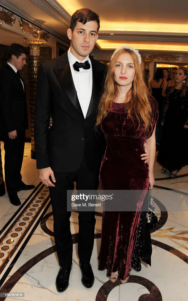 Mark Ronson (L) and Josephine de la Baume attend a drinks reception at the Amy Winehouse Foundation Ball held at The Dorchester on November 20, 2012 in London, England.