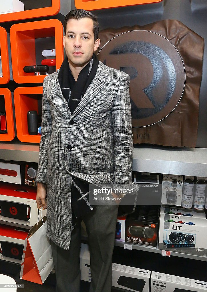 <a gi-track='captionPersonalityLinkClicked' href=/galleries/search?phrase=Mark+Ronson&family=editorial&specificpeople=853261 ng-click='$event.stopPropagation()'>Mark Ronson</a> attends the Charlotte Ronson Holiday Party At RadioShack Pop-Up Store in Times Square on December 12, 2013 in New York City.