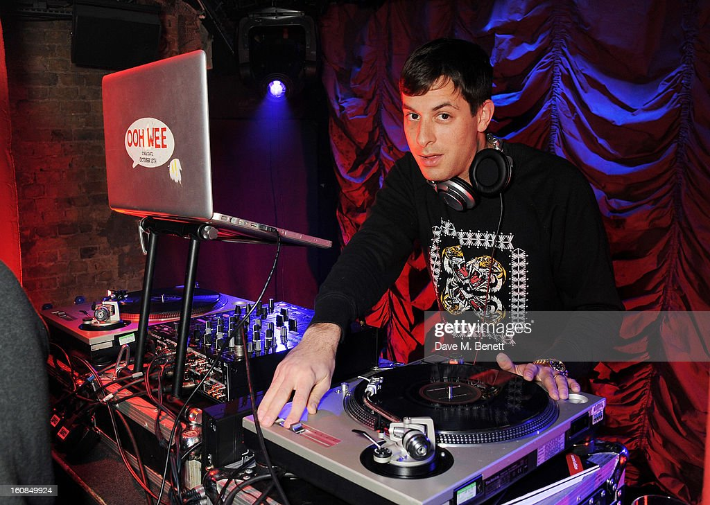 <a gi-track='captionPersonalityLinkClicked' href=/galleries/search?phrase=Mark+Ronson&family=editorial&specificpeople=853261 ng-click='$event.stopPropagation()'>Mark Ronson</a> DJ's at the 2nd Anniversary of The Box with Belvedere Vodka on February 6, 2013 in London, England.