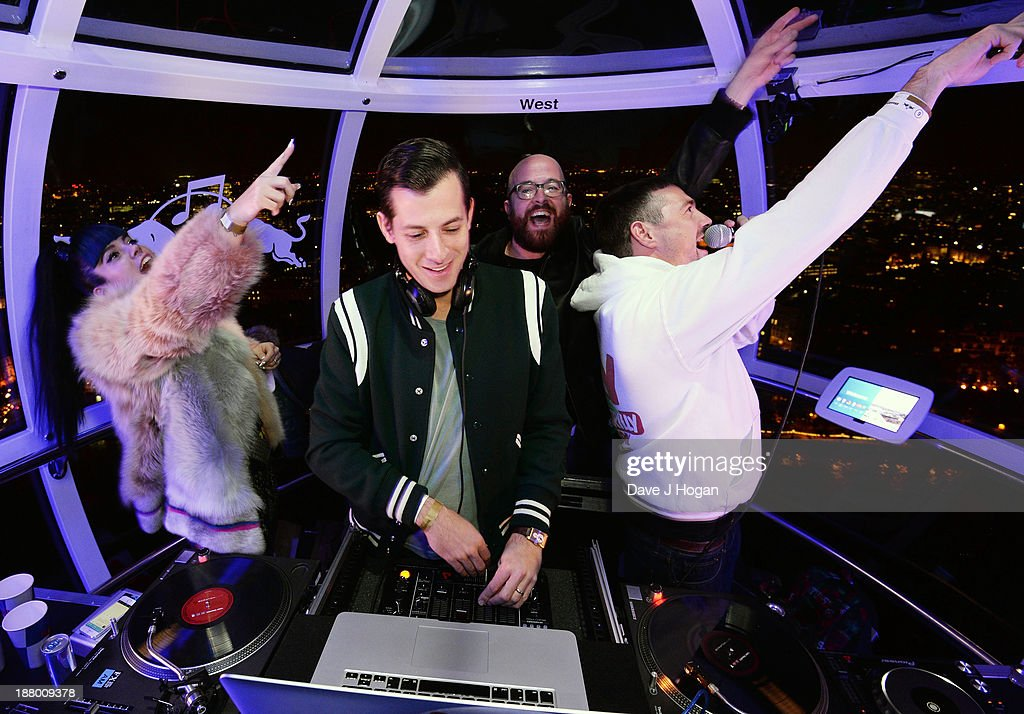 <a gi-track='captionPersonalityLinkClicked' href=/galleries/search?phrase=Mark+Ronson&family=editorial&specificpeople=853261 ng-click='$event.stopPropagation()'>Mark Ronson</a> performs with support from <a gi-track='captionPersonalityLinkClicked' href=/galleries/search?phrase=Lily+Allen&family=editorial&specificpeople=724899 ng-click='$event.stopPropagation()'>Lily Allen</a> at Red Bull Revolutions in Sound on the EDF Energy London Eye, a celebration of UK club culture with 30 of the most legendary club nights in 30 capsules and streamed live on www.revolutionsinsound.com on November 14, 2013 in London, England.