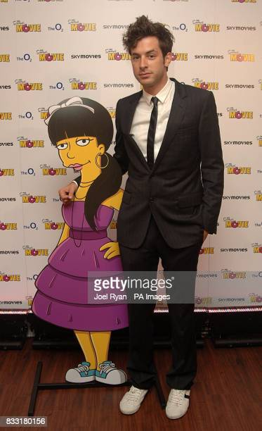 Mark Ronson with a cut out of Lily Allen arrives for the UK Premiere of The Simpsons Movie at the Vue Cinema The O2 Peninsula Square London