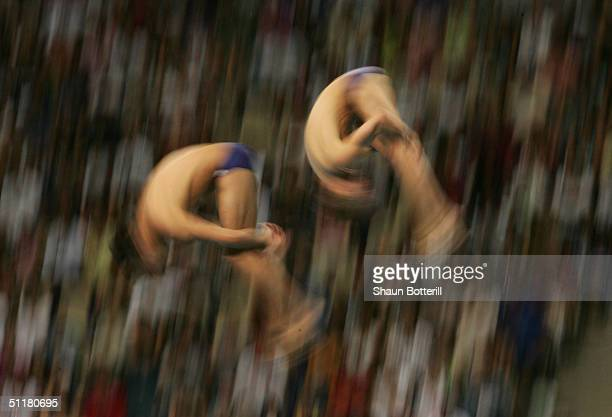 Mark Ruiz and Kyle Prandi of USA compete in the men's synchronised diving 10 metre platform event on August 14 2004 during the Athens 2004 Summer...
