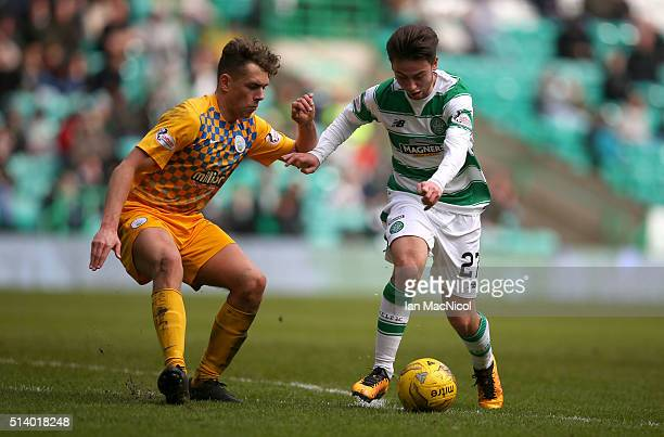 Mark Russell of Greenock Morton vies with Patrick Roberts of Celtic during the William Hill Scottish Cup Quarter Final match between Celtic and...