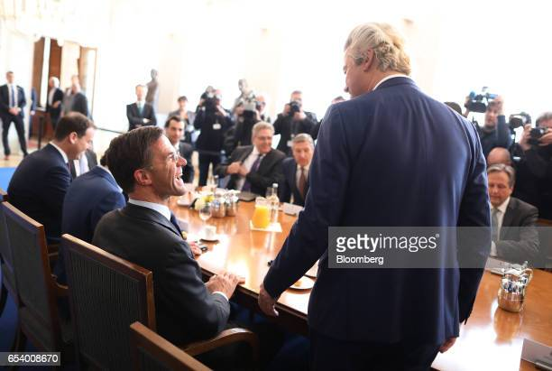 Mark Rutte Dutch prime minister and leader of the Liberal Party left greets Geert Wilders leader of the Dutch Freedom Party during a meeting at the...