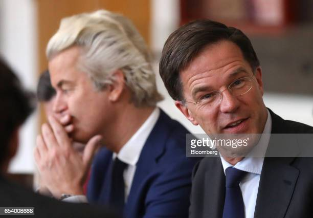 Mark Rutte Dutch prime minister and leader of the Liberal Party right sits next to Geert Wilders leader of the Dutch Freedom Party during a meeting...