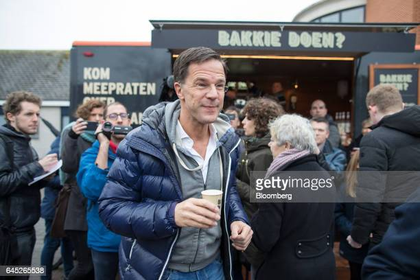 Mark Rutte Dutch prime minister and leader of the Liberal Party takes a drink from a campaign coffee van during a campaign event in Wormerveer...