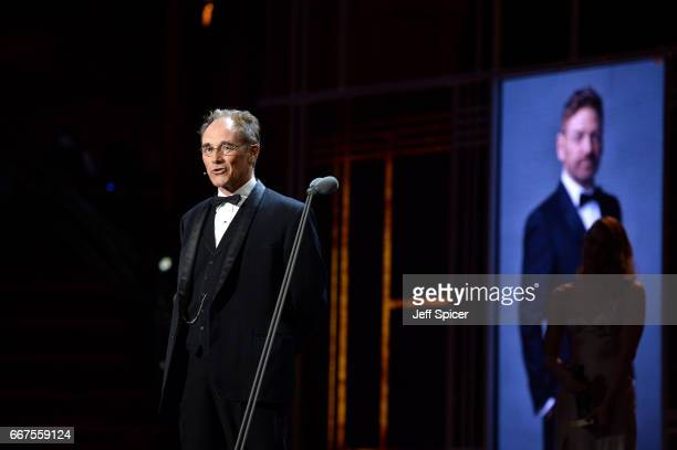 Mark Rylance presents Sir Kenneth Branagh with his special award on stage during The Olivier Awards 2017 at Royal Albert Hall on April 9 2017 in...