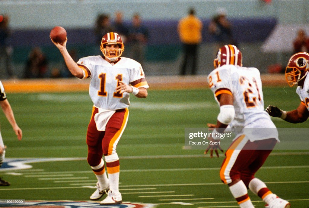 Mark Rypien #11 of the Washington Redskins looks to pass to Earnest Byner #21 against the Buffalo Bills during Super Bowl XXVI at the Metrodome in Minneapolis, Minnesota January 26, 1992. The Redskins won the Super Bowl 37-24.