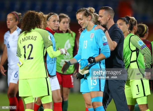 Mark Sampson manager / head coach of England Women with goalkeeper Siobhan Chamberlain of England Women as she shakes hands with Patricia Morais of...