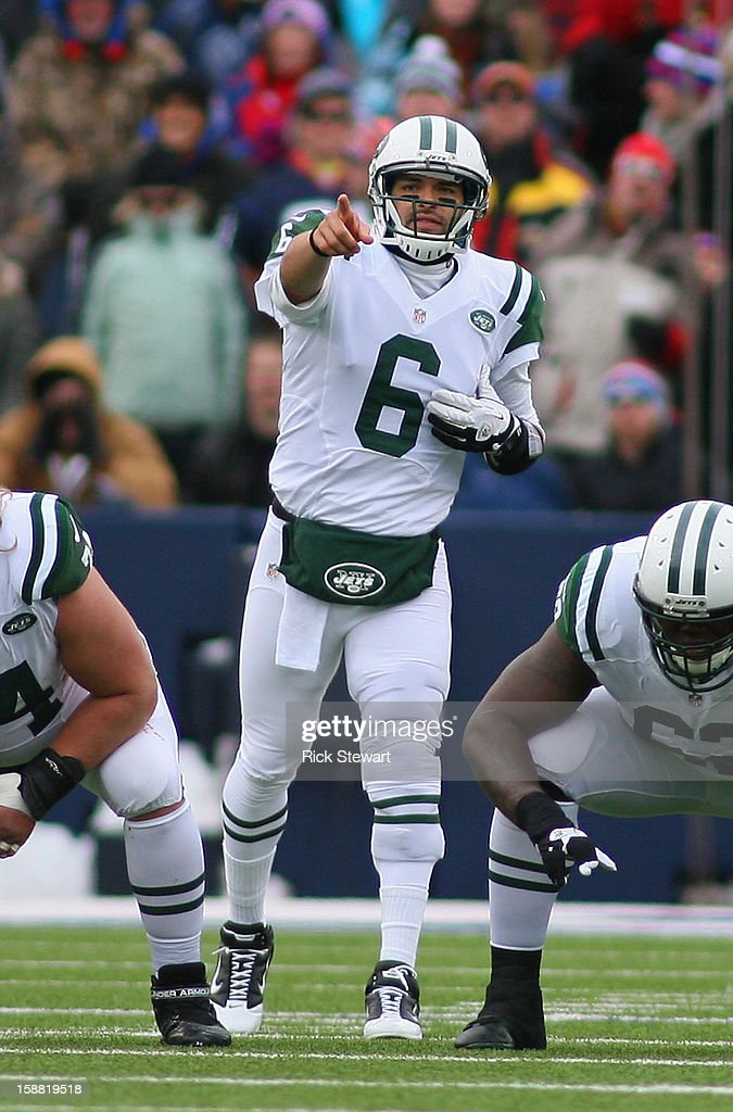 <a gi-track='captionPersonalityLinkClicked' href=/galleries/search?phrase=Mark+Sanchez&family=editorial&specificpeople=690406 ng-click='$event.stopPropagation()'>Mark Sanchez</a> #6 of the New York Jets calls signals against the Buffalo Bills at Ralph Wilson Stadium on December 30, 2012 in Orchard Park, New York.