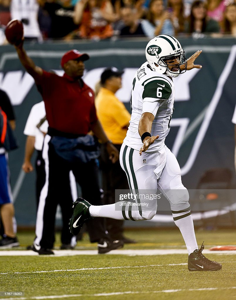 Mark Sanchez #6 of the New York Jets celebrates a touchdown against the Jacksonville Jaguars during their preseason game at MetLife Stadium on August 17, 2013 in East Rutherford, New Jersey.