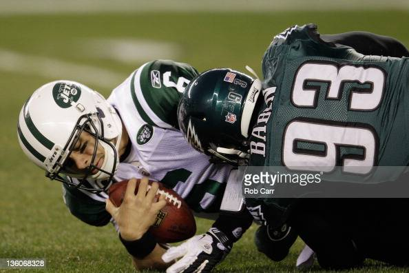 Mark Sanchez of the New York Jets is sacked by Jason Babin of the Philadelphia Eagles during the first half at Lincoln Financial Field on December 18...