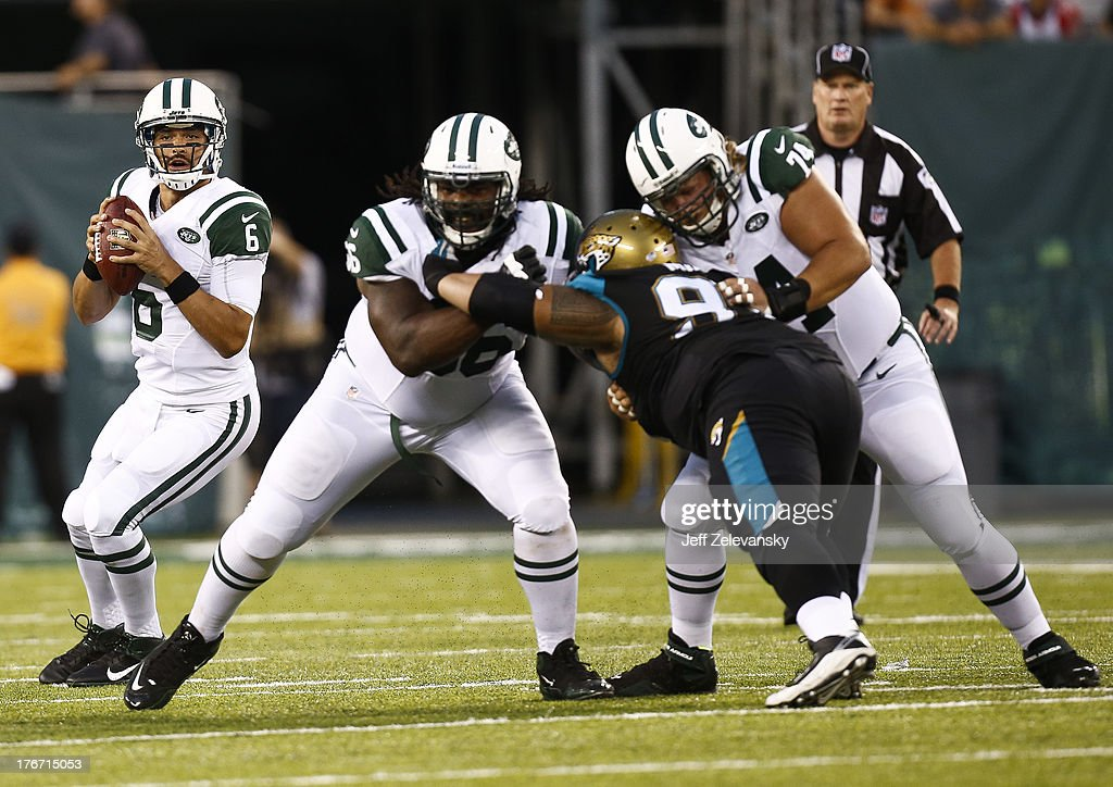 <a gi-track='captionPersonalityLinkClicked' href=/galleries/search?phrase=Mark+Sanchez&family=editorial&specificpeople=690406 ng-click='$event.stopPropagation()'>Mark Sanchez</a> #6 of the New York Jets looks for an open man against the Jacksonville Jaguars during their preseason game at MetLife Stadium on August 17, 2013 in East Rutherford, New Jersey.