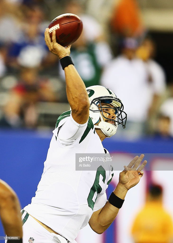 <a gi-track='captionPersonalityLinkClicked' href=/galleries/search?phrase=Mark+Sanchez&family=editorial&specificpeople=690406 ng-click='$event.stopPropagation()'>Mark Sanchez</a> #6 of the New York Jets passes against the New York Giants during their pre season game at MetLife Stadium on August 24, 2013 in East Rutherford, New Jersey.