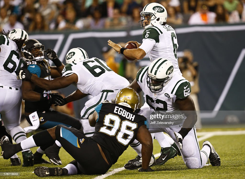 Mark Sanchez #6 of the New York Jets scrambles against the Jacksonville Jaguars during their preseason game at MetLife Stadium on August 17, 2013 in East Rutherford, New Jersey.