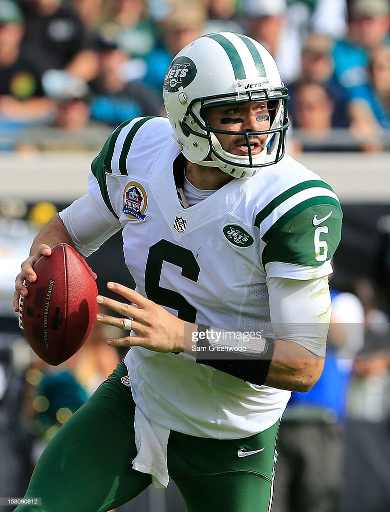 <a gi-track='captionPersonalityLinkClicked' href=/galleries/search?phrase=Mark+Sanchez&family=editorial&specificpeople=690406 ng-click='$event.stopPropagation()'>Mark Sanchez</a> #6 of the New York Jets scrambles for yardage during the game against the Jacksonville Jaguars at EverBank Field on December 9, 2012 in Jacksonville, Florida.