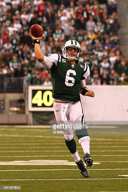 Mark Sanchez of the New York Jets throws the go ahead touchdown to Santonio Holmes against the Buffalo Bills during their game on November 27 2011 at...