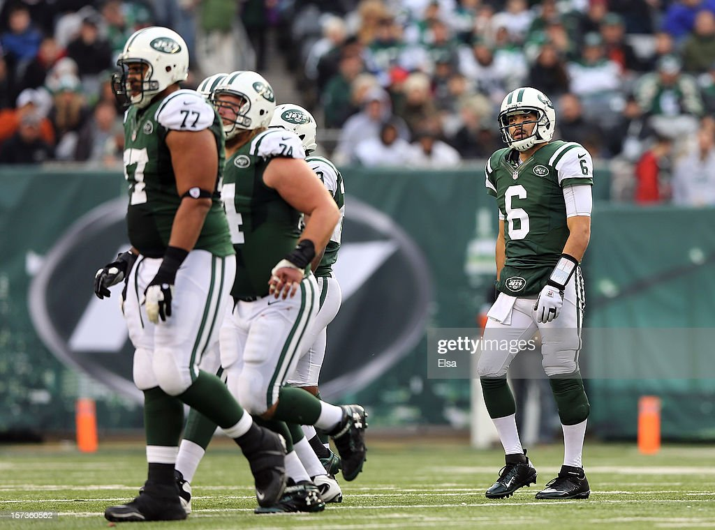 <a gi-track='captionPersonalityLinkClicked' href=/galleries/search?phrase=Mark+Sanchez&family=editorial&specificpeople=690406 ng-click='$event.stopPropagation()'>Mark Sanchez</a> #6 of the New York Jets walks off the field after failing to get the first down in the third quarter against the Arizona Cardinals on December 2, 2012 at MetLife Stadium in East Rutherford, New Jersey. The New York Jets defeated the Arizona Cardinals 7-6.