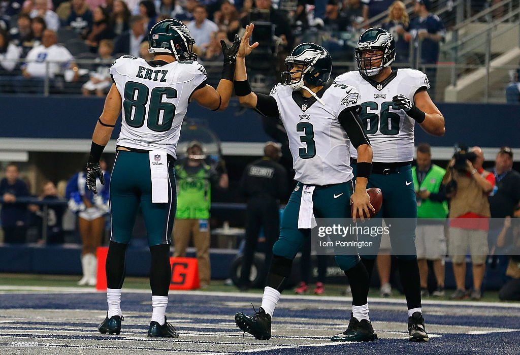 <a gi-track='captionPersonalityLinkClicked' href=/galleries/search?phrase=Mark+Sanchez&family=editorial&specificpeople=690406 ng-click='$event.stopPropagation()'>Mark Sanchez</a> #3 of the Philadelphia Eagles is congratulated by <a gi-track='captionPersonalityLinkClicked' href=/galleries/search?phrase=Zach+Ertz&family=editorial&specificpeople=7172878 ng-click='$event.stopPropagation()'>Zach Ertz</a> #86 of the Philadelphia Eagles as <a gi-track='captionPersonalityLinkClicked' href=/galleries/search?phrase=Andrew+Gardner&family=editorial&specificpeople=1713796 ng-click='$event.stopPropagation()'>Andrew Gardner</a> #66 of the Philadelphia Eagles is near after he scored a touchdown against the Dallas Cowboys in the first half at AT&T Stadium on November 27, 2014 in Arlington, Texas.