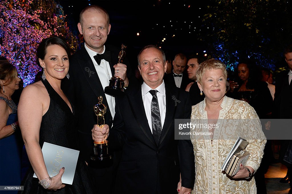 Mark Sanger (2nd L), winner of Best Achievement in Editing for 'Gravity,' and Glenn Freemantle (2nd R), winner of Best Achievement in Sound Editing for 'Gravity,' with guests attend the Oscars Governors Ball at Hollywood & Highland Center on March 2, 2014 in Hollywood, California.