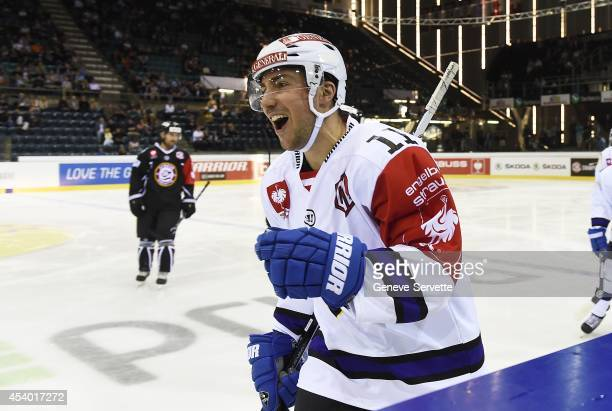 Mark Santorelli of Villach SV celebrates his goal after 14 seconds during the Champions Hockey League group stage game between GeneveServette and...