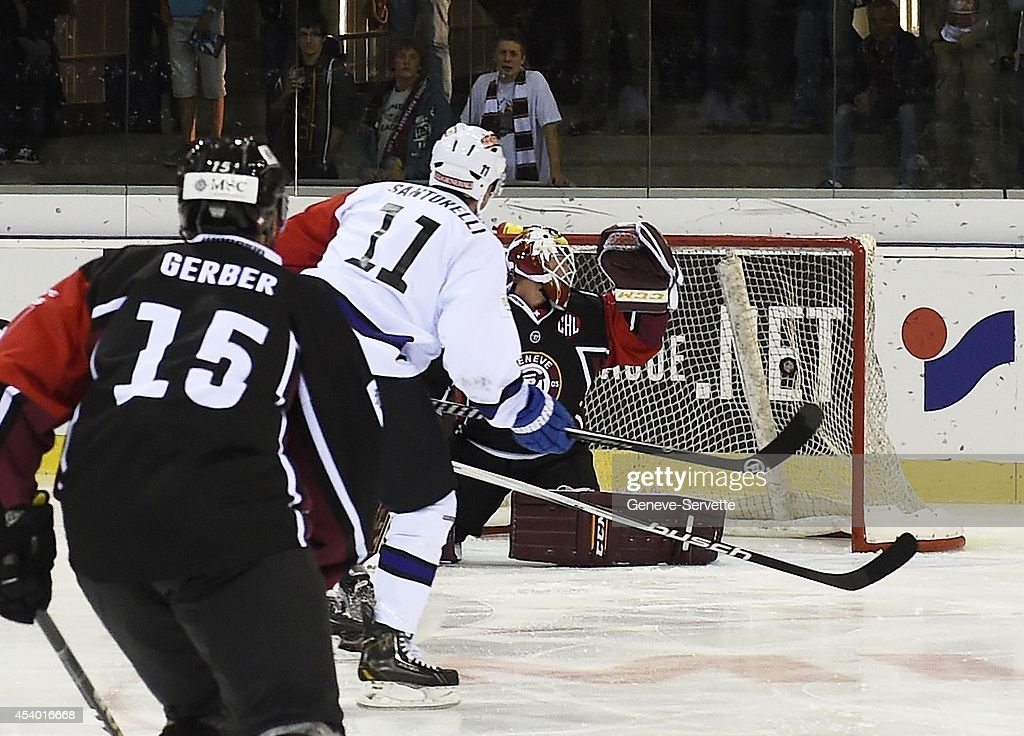 Mark Santorelli of Villach SV shots a goal 0-1 after 14 seconds against goalie Christophe Bays of Geneve-Servette during the Champions Hockey League group stage game between Geneve-Servette and Villach SV on August 23, 2014 in Geneva, Switzerland.