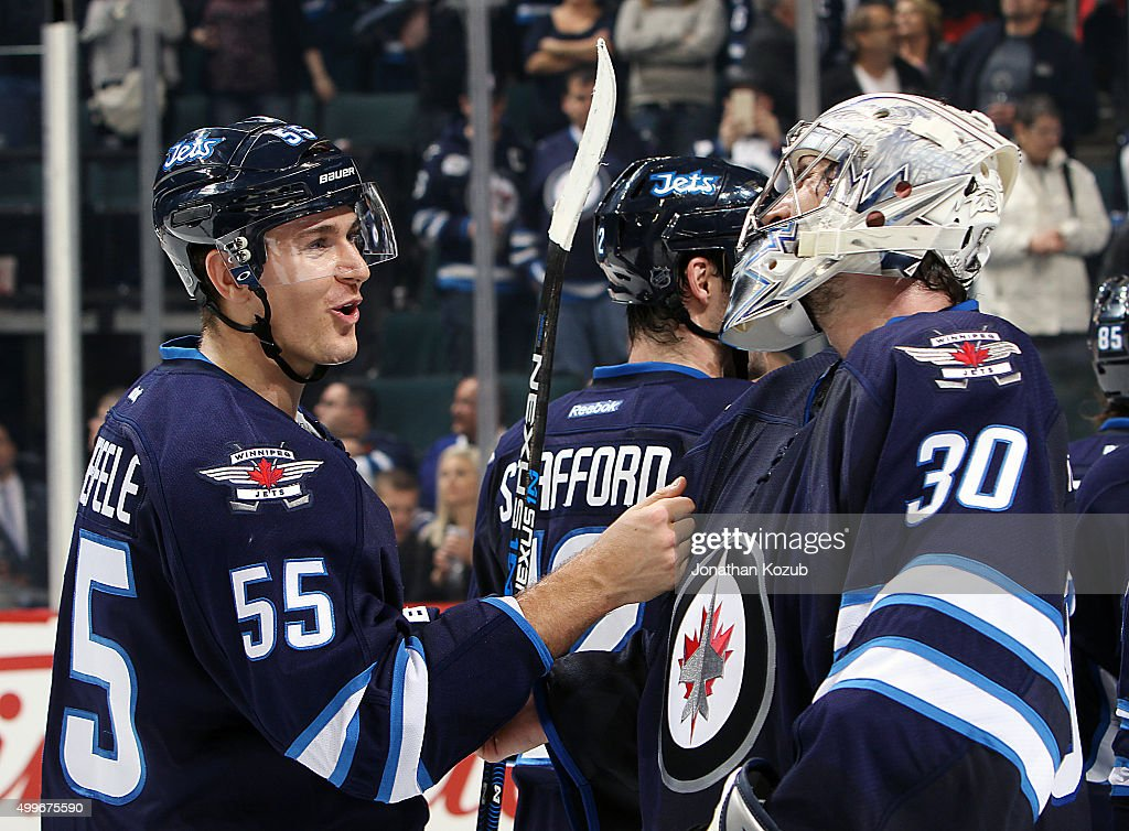 <a gi-track='captionPersonalityLinkClicked' href=/galleries/search?phrase=Mark+Scheifele&family=editorial&specificpeople=7342540 ng-click='$event.stopPropagation()'>Mark Scheifele</a> #55 and goaltender <a gi-track='captionPersonalityLinkClicked' href=/galleries/search?phrase=Connor+Hellebuyck&family=editorial&specificpeople=10551764 ng-click='$event.stopPropagation()'>Connor Hellebuyck</a> #30 of the Winnipeg Jets are all smiles as they celebrate a 6-1 victory over the Toronto Maple Leafs at the MTS Centre on December 2, 2015 in Winnipeg, Manitoba, Canada.