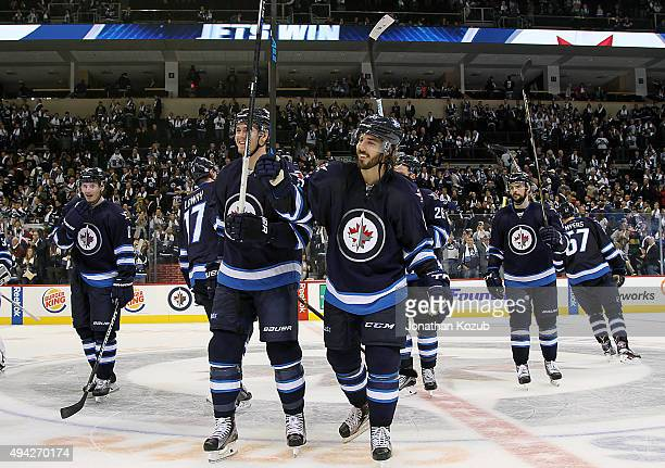 Mark Scheifele and Mathieu Perreault of the Winnipeg Jets are all smiles as they salute the fans following a 54 victory over the Minnesota Wild at...