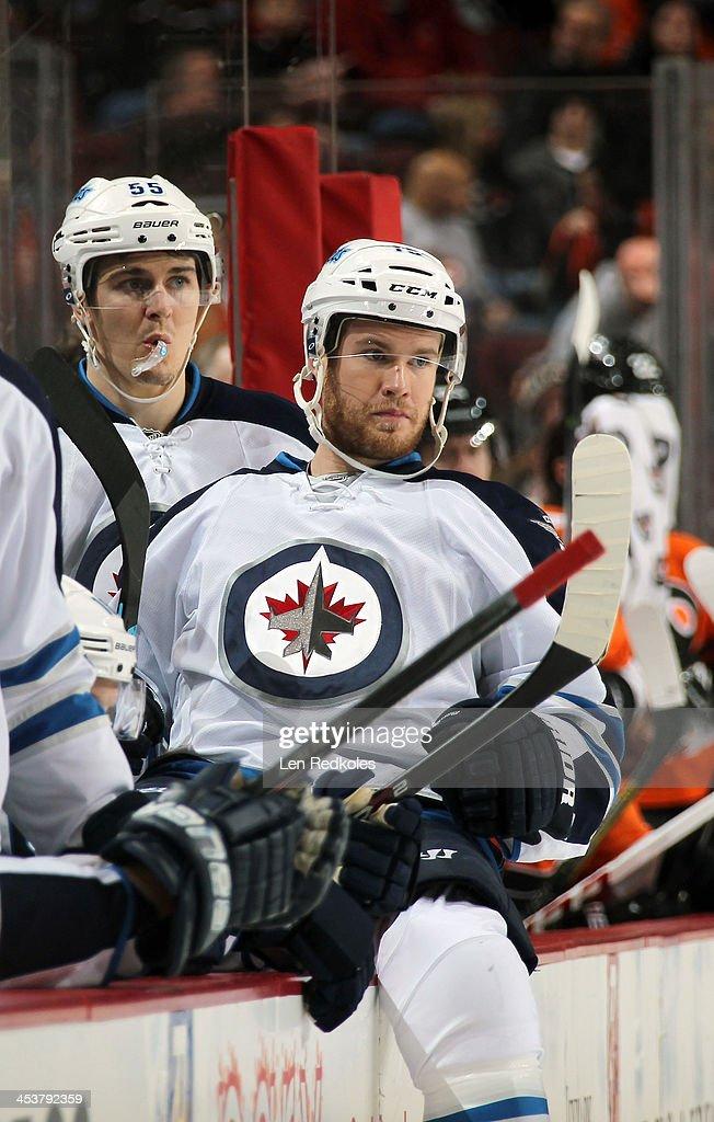 Mark Scheifele and Matt Halischuk of the Winnipeg Jets look on from the bench against the Philadelphia Flyers on November 29 2013 at the Wells Fargo...