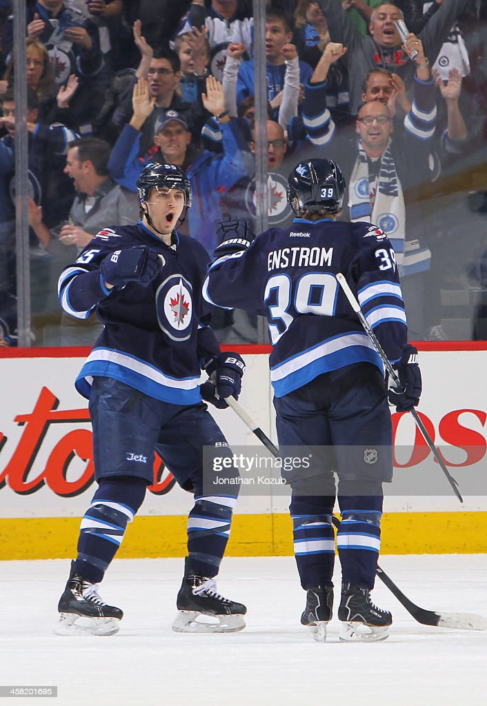 <a gi-track='captionPersonalityLinkClicked' href=/galleries/search?phrase=Mark+Scheifele&family=editorial&specificpeople=7342540 ng-click='$event.stopPropagation()'>Mark Scheifele</a> #55 and <a gi-track='captionPersonalityLinkClicked' href=/galleries/search?phrase=Tobias+Enstrom&family=editorial&specificpeople=2538468 ng-click='$event.stopPropagation()'>Tobias Enstrom</a> #39 of the Winnipeg Jets celebrate a first period goal against the Florida Panthers at the MTS Centre on December 20, 2013 in Winnipeg, Manitoba, Canada.