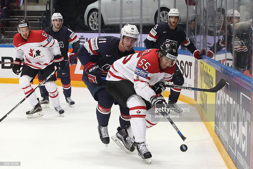 Mark Scheifele #55 of Canada and Brock Nelson #11 of USA battle for the puck at Ice Palace on May 21, 2016 in Moscow, Russia. Canada defeated USA