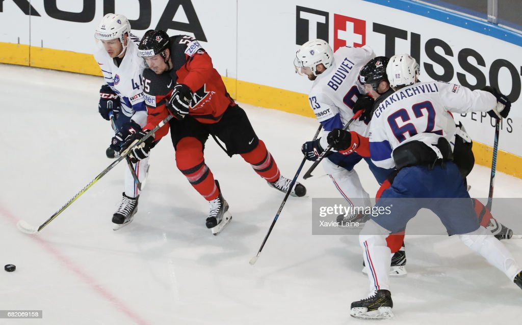 Mark Scheifele of Canada in action with Olivier Dame-Malka #44, Florian Chiakachvili #62 and Maurin Bouvet #23 of France during the 2017 IIHF Ice Hockey World Championship game between Canada and France at AccorHotels Arena on May 11, 2017 in Paris, France.