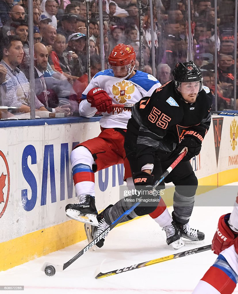 Mark Scheifele #55 of Team North America collides with Dmitry Kulikov #7 of Team Russia along the boards during the World Cup of Hockey 2016 at Air Canada Centre on September 19, 2016 in Toronto, Ontario, Canada.