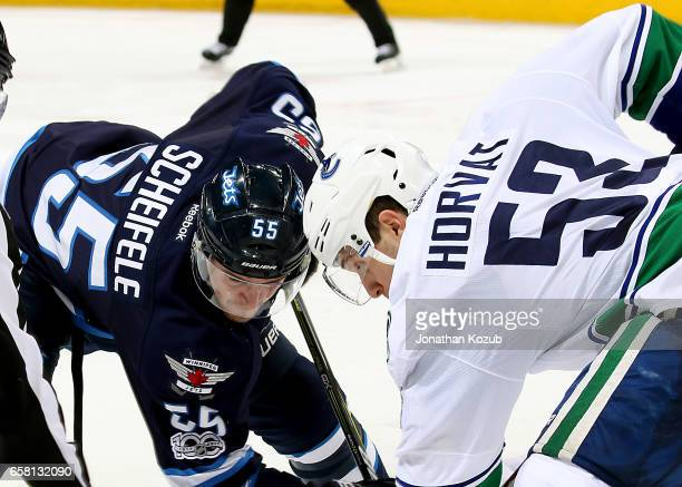 Mark Scheifele of the Winnipeg Jets and Bo Horvat of the Vancouver Canucks get set for a third period faceoff at the MTS Centre on March 26 2017 in...