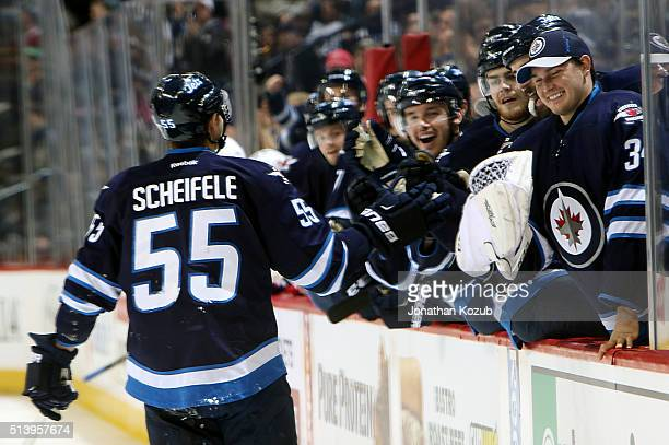 Mark Scheifele of the Winnipeg Jets celebrates a second period goal against the Montreal Canadiens with teammates at the bench at the MTS Centre on...
