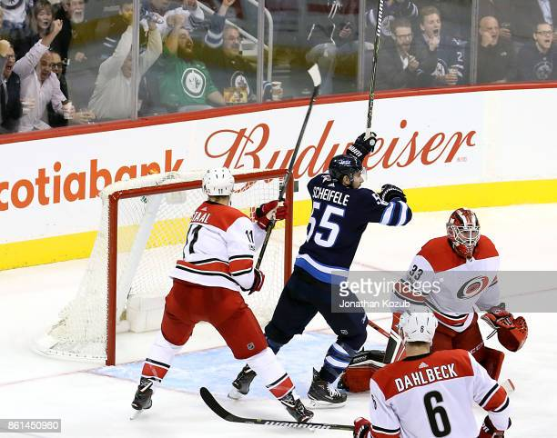 Mark Scheifele of the Winnipeg Jets celebrates after teammate Nikolaj Ehlers scores a third period goal against the Carolina Hurricanes at the Bell...