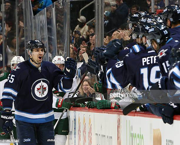 Mark Scheifele of the Winnipeg Jets celebrates his first period goal against the Minnesota Wild with teammates at the bench at the MTS Centre on...