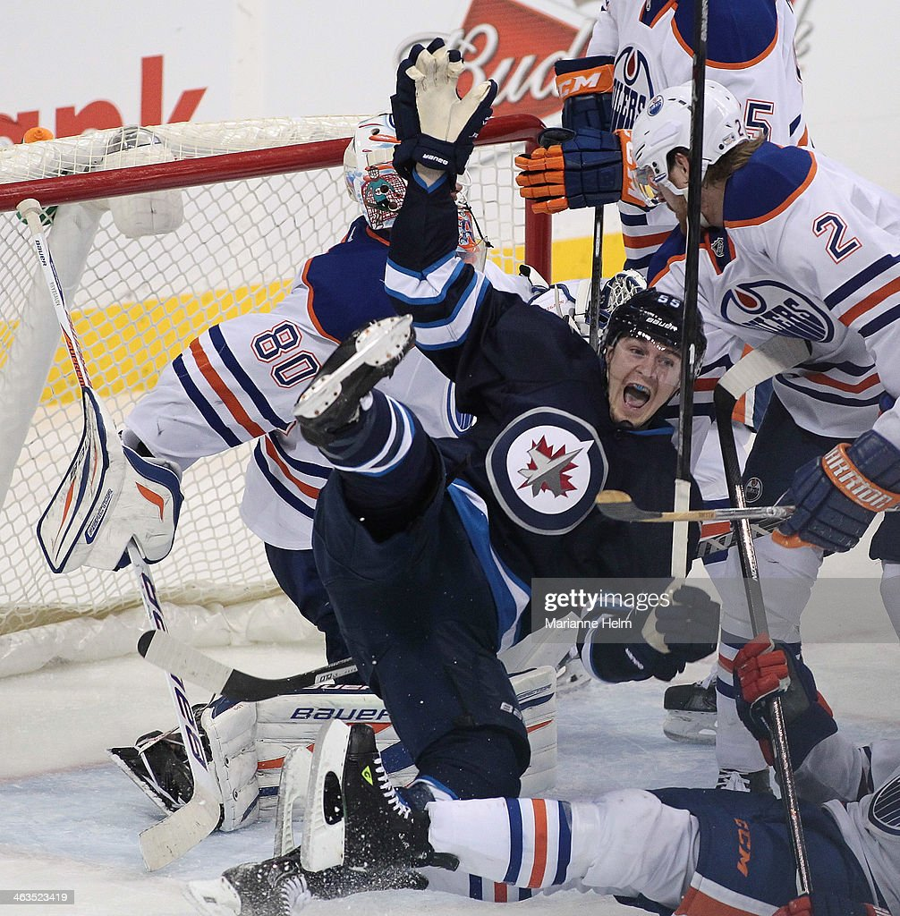 <a gi-track='captionPersonalityLinkClicked' href=/galleries/search?phrase=Mark+Scheifele&family=editorial&specificpeople=7342540 ng-click='$event.stopPropagation()'>Mark Scheifele</a> #55 of the Winnipeg Jets celebrates his goal against <a gi-track='captionPersonalityLinkClicked' href=/galleries/search?phrase=Ilya+Bryzgalov&family=editorial&specificpeople=2285430 ng-click='$event.stopPropagation()'>Ilya Bryzgalov</a> #80 of the Edmonton Oilers in third period action in an NHL game at the MTS Centre on January 18, 2014 in Winnipeg, Manitoba, Canada.